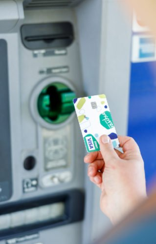 Debit card being used at ATM machine