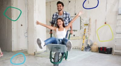 Man and woman working on house